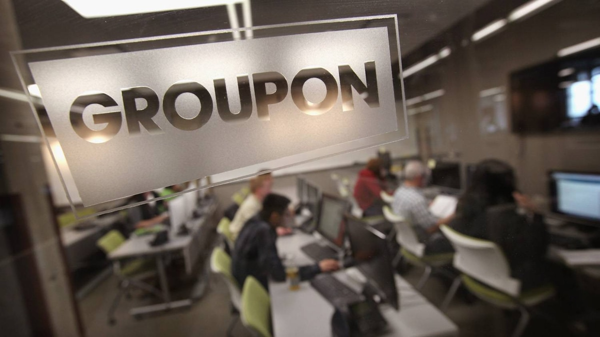 The Groupon logo is engraved in a glass office partition in the company's international headquarters on June 10, 2011 in Chicago, Illinois.