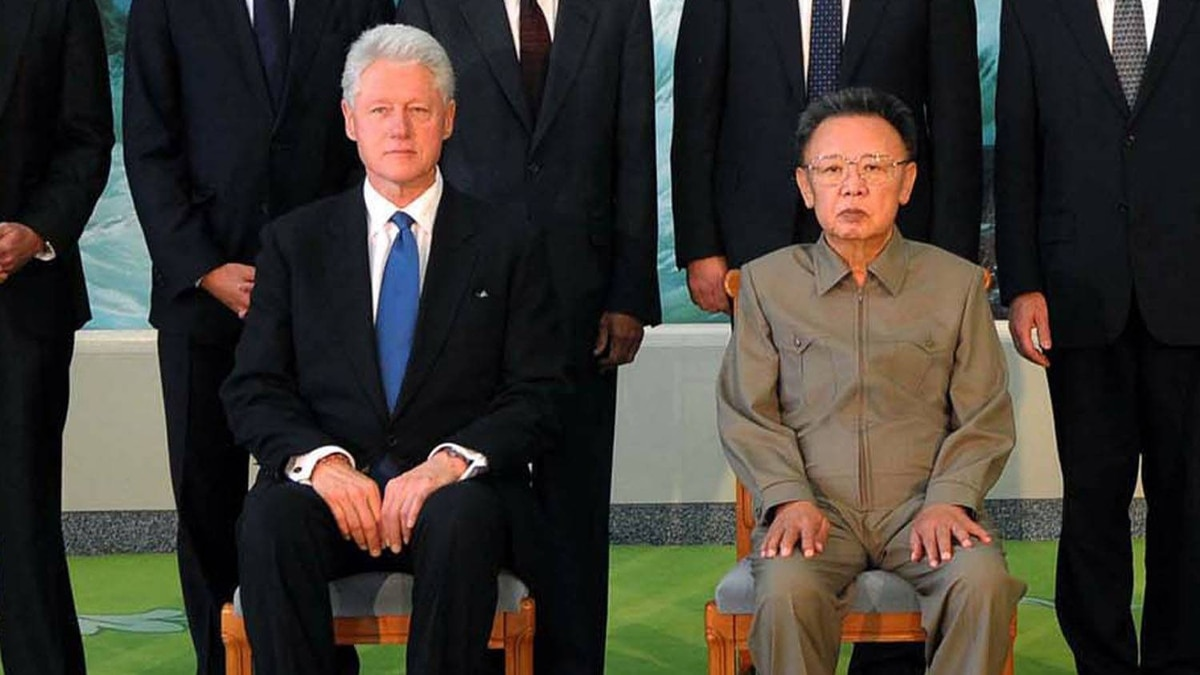 This photo taken on August 4, 2009 and released by North Korea's official Korean Central News Agency shows North Korean leader Kim Jong-il posing with former US President Bill Clinton and his delegation members in Pyongyang.