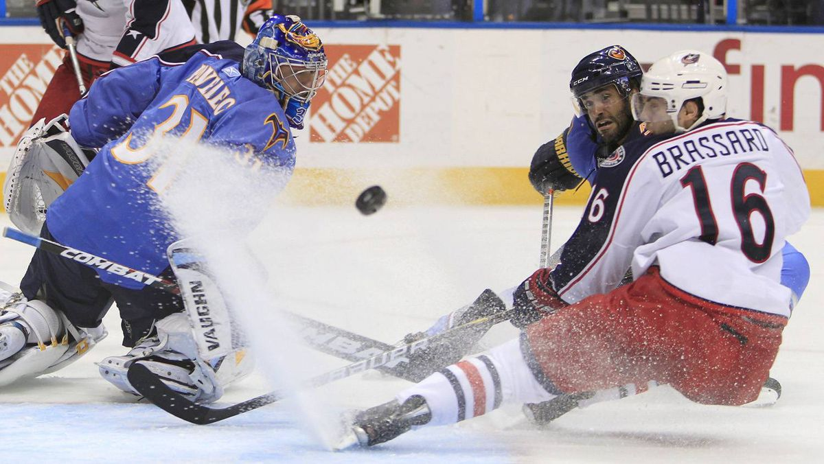 Columbus Blue Jackets center Derick Brassard (16) chases the puck with Atlanta Thrashers defenseman Johnny Oduya, of Sweden, second from right, as Atlanta Thrashers goalie Ondrej Pavelec (31), of the Czech Republic, looks on during the second period of an NHL hockey game Thursday.