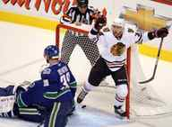 Chicago Blackhawks' Kris Versteeg celebrates after scoring the first goal against Vancouver Canucks goaltender Roberto Luongo as Canucks' Pavol Demitra looks on during first period of game 3 NHL western conference playoff hockey action at GM Place in Vancouver, Wednesday, May 5, 2010