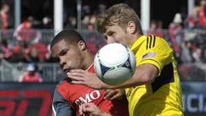 Toronto FC forward Ryan Johnson (L) and Columbus Crew forward Kirk Urso battle for the ball during the first half of their MLS soccer game in Toronto March 31, 2012.