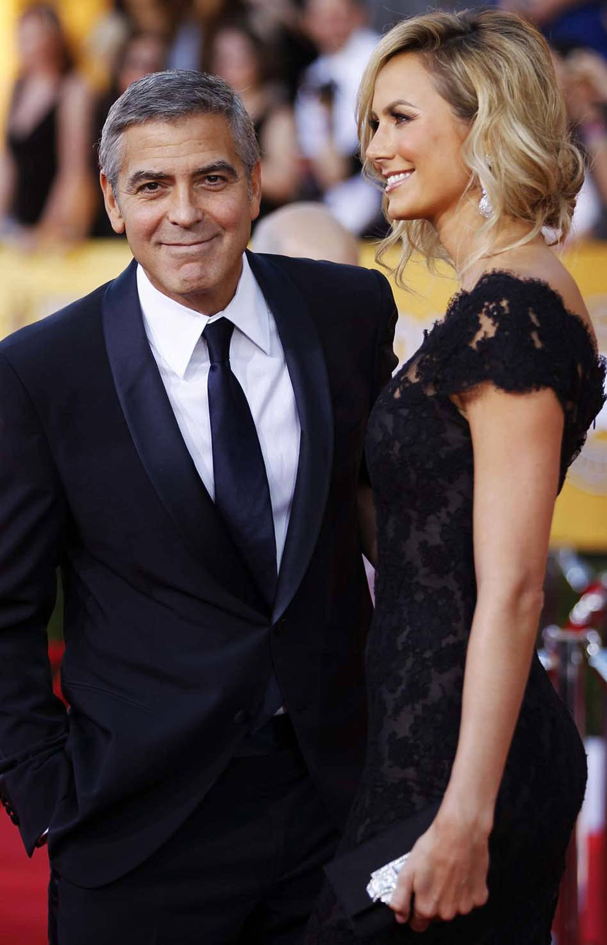 """Say anything about my girlfriend's dress and I'll reach out of the computer screen and make sure you never have a descendant,"" George Clooney says with a smile at the SAG awards in Los Angeles on Sunday."