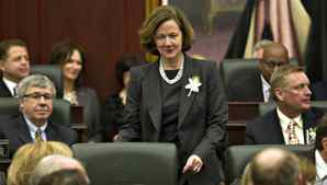 Alberta Premier Alison Redford makes her way to her seat before the Speech from the Throne at the Alberta Legislature in Edmonton on Feb. 7, 2012. Jason Franson/The Canadian Press