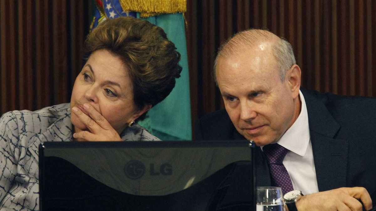 Brazil's President Dilma Rousseff (L) and Brazil's Finance Minister Guido Mantega participate in a meeting with businessmen at the Planalto Palace in Brasilia May 3, 2012.