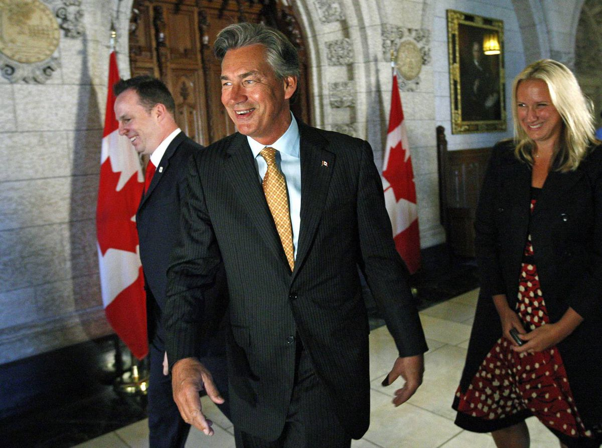 Gary Doer, Canada's ambassador-designate to the United States, laughs after speaking to reporters in the foyer of the House of Commons on Aug. 28, 2009. Also pictured are Prime Minister Stephen Harper's deputy press secretaries Andrew MacDougall and Karine Leroux.