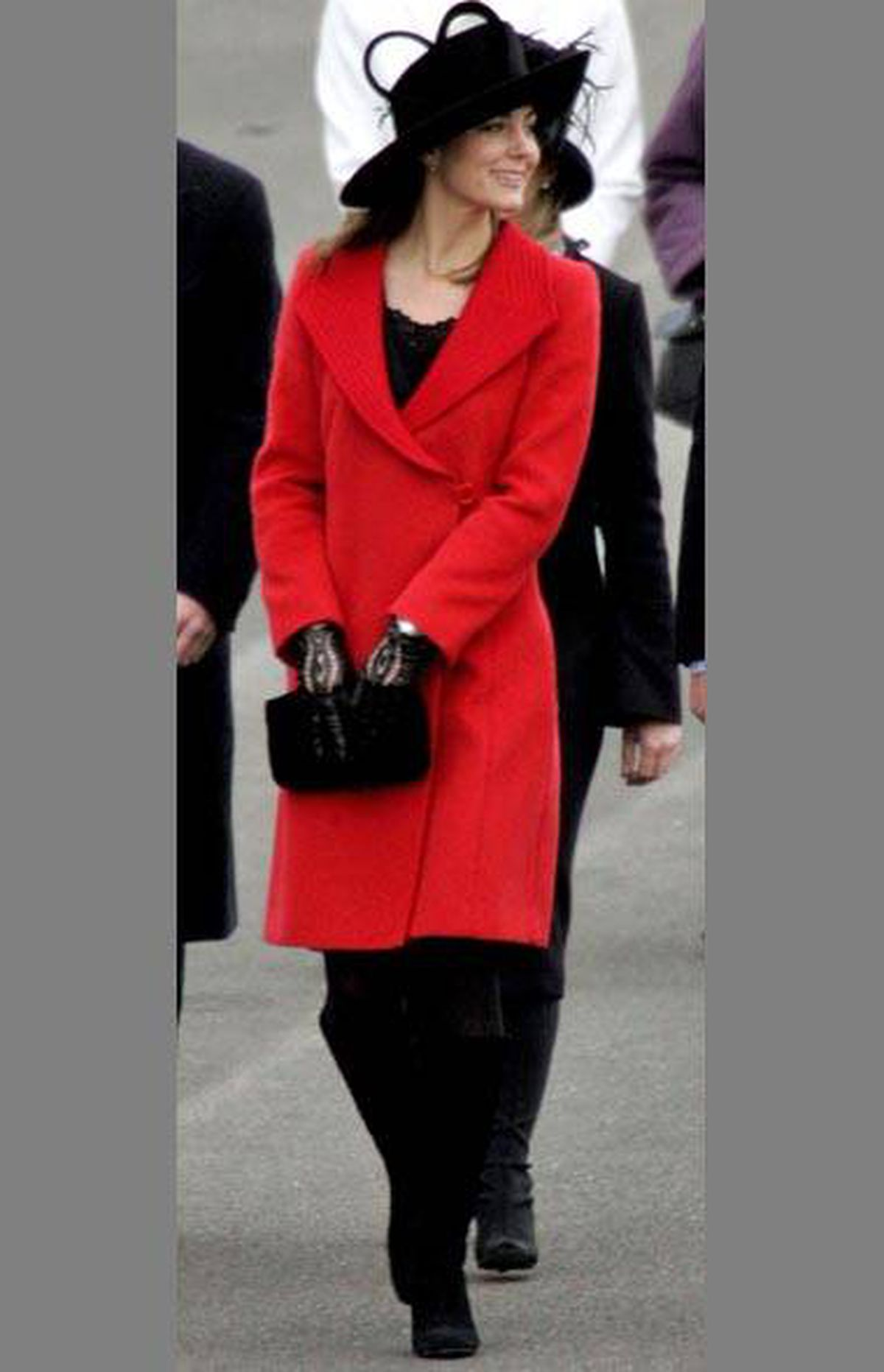 She may opt for understatement over ostentatious, but it's never boring. Take this slick, structured red coat: It reads more cool than calculated.