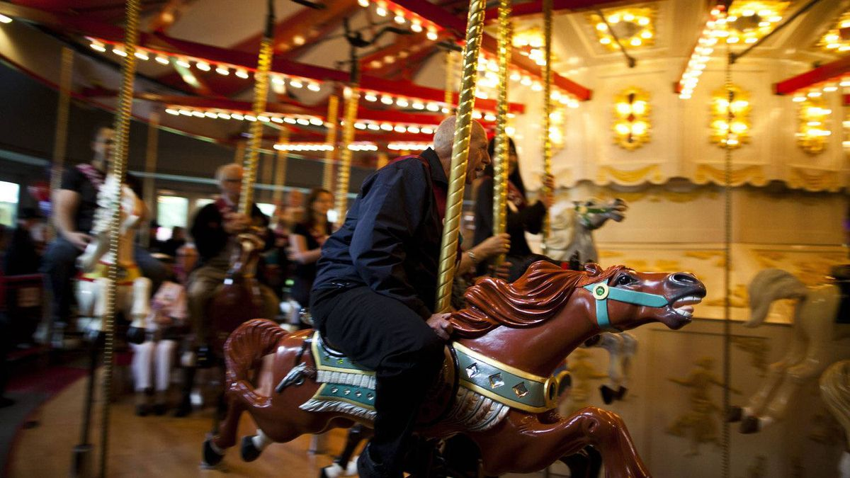 Keith Jamieson, rides Phar Lap at the C.W. Parker Carousel during opening day celebrations at the at the Burnaby Village Museum Saturday, May 5, 2012.