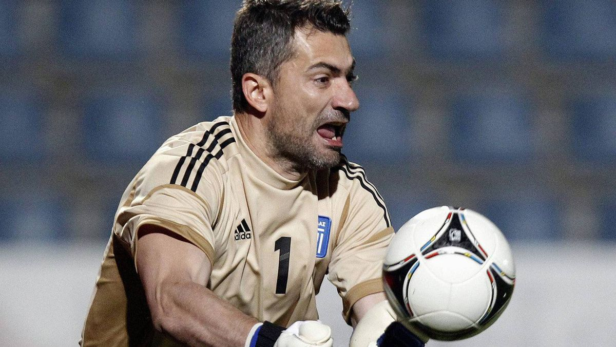 Greece's Chalkias Konstantinos saves a ball during their international friendly soccer match against Slovenia in Kufstein May 26, 2012. The teams tied 1-1. REUTERS/Dominic Ebenbichler
