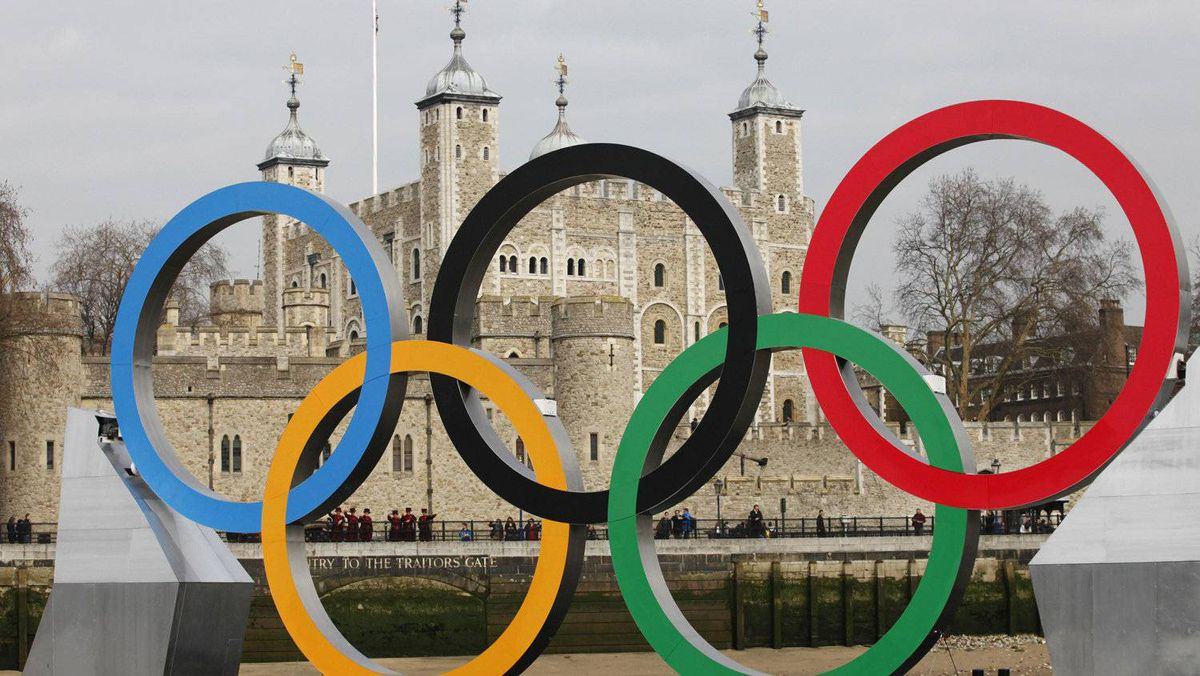 Olympic rings are mounted on a barge on the River Thames in London, Feb. 28, 2012. While Canadian broadcasters bide their time, waiting to see whether NHL players will participate in the 2014 Winter Games in Sochi, Russia, Yahoo Inc. is reportedly considering a bid for Canadian broadcast rights for event.