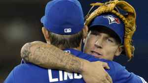 Toronto Blue Jays third baseman Brett Lawrie (back) and first baseman Adam Lind celebrate their win against the Seattle Mariners during the ninth inning of their MLB American League baseball game in Toronto April 28, 2012. REUTERS/Mike Cassese