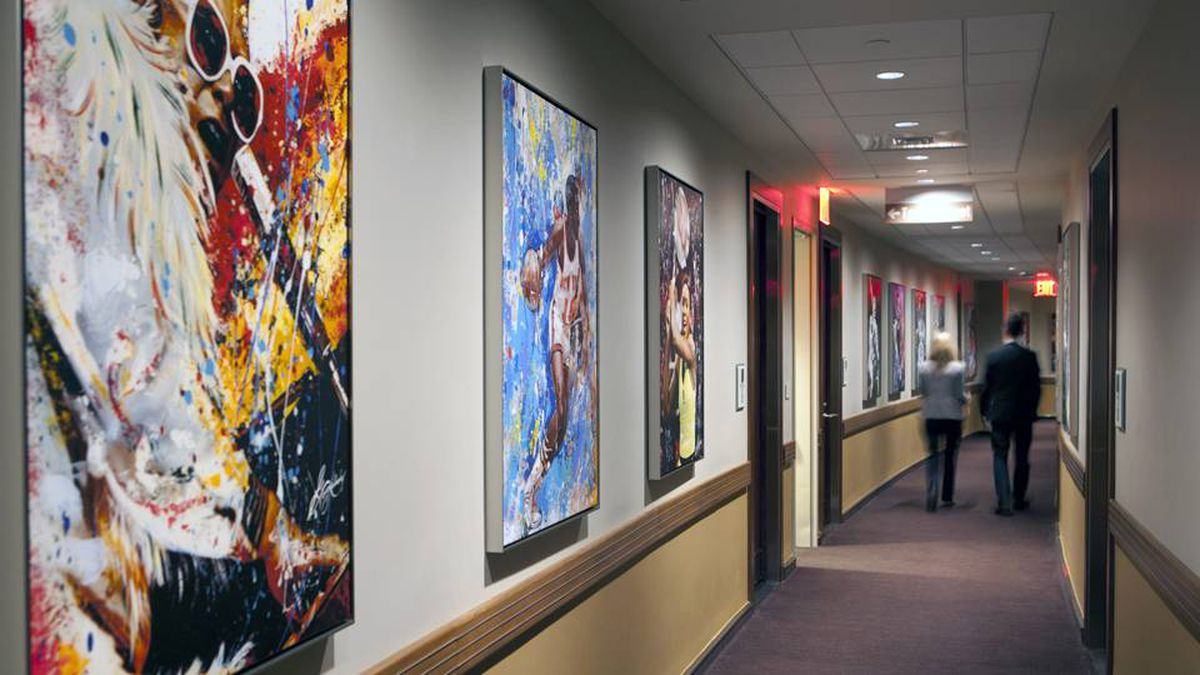 - One of the main features of the renovated Garden is the transformation of what was previously storage and back-stage space into revenue-generating space. Here is the hallway that leads to the ice-level luxury suites, it's adorned by prints photographed and painted by longtime MSG photographer George Kalinsky, who has been the building's official photographer for 46 years.