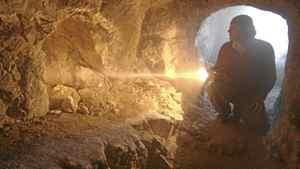 Simcha Jacobovici examines a 1st century burial tomb.
