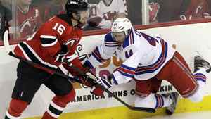 New Jersey Devils' Jacob Josefson, of Sweden, left, struggles with New York Rangers' Steve Eminger during the first period of Game 4 of an NHL hockey Stanley Cup Eastern Conference final playoff series, Monday, May 21, 2012, in Newark, N.J. (AP Photo/Kathy Willens)