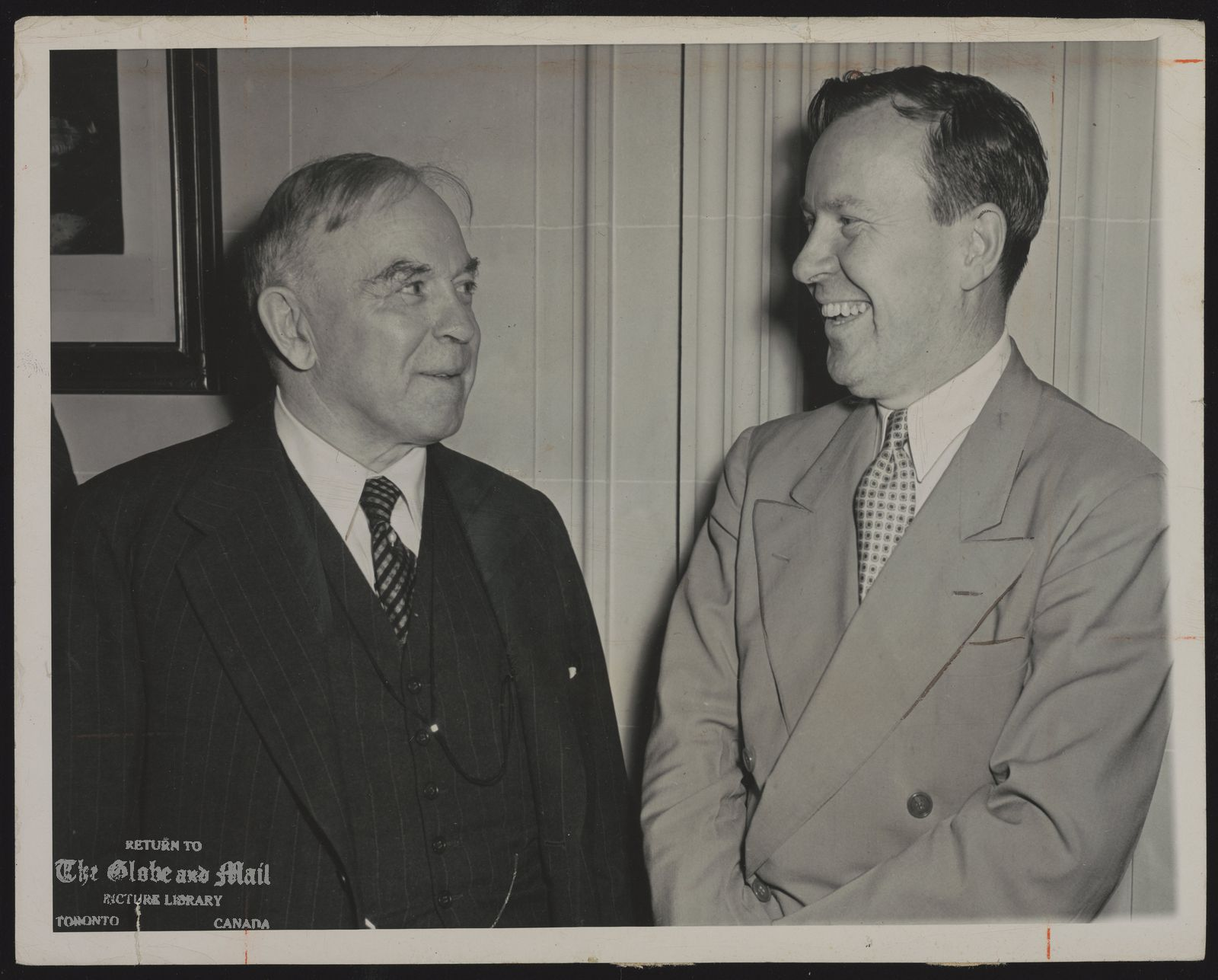 MacKENZIE KING Prime Minister of Canada. Added caption: Prime Minister MacKenzie King, left, of Canada meets Ambassador Lester B. Pearson at the Canadian Embassy in Washington, DC, September 29, 1945, following the Prime Minister's arrival by plane from Canada. King's itinerary will include a visit with President Truman and a stop in New York City. AP PHOTO