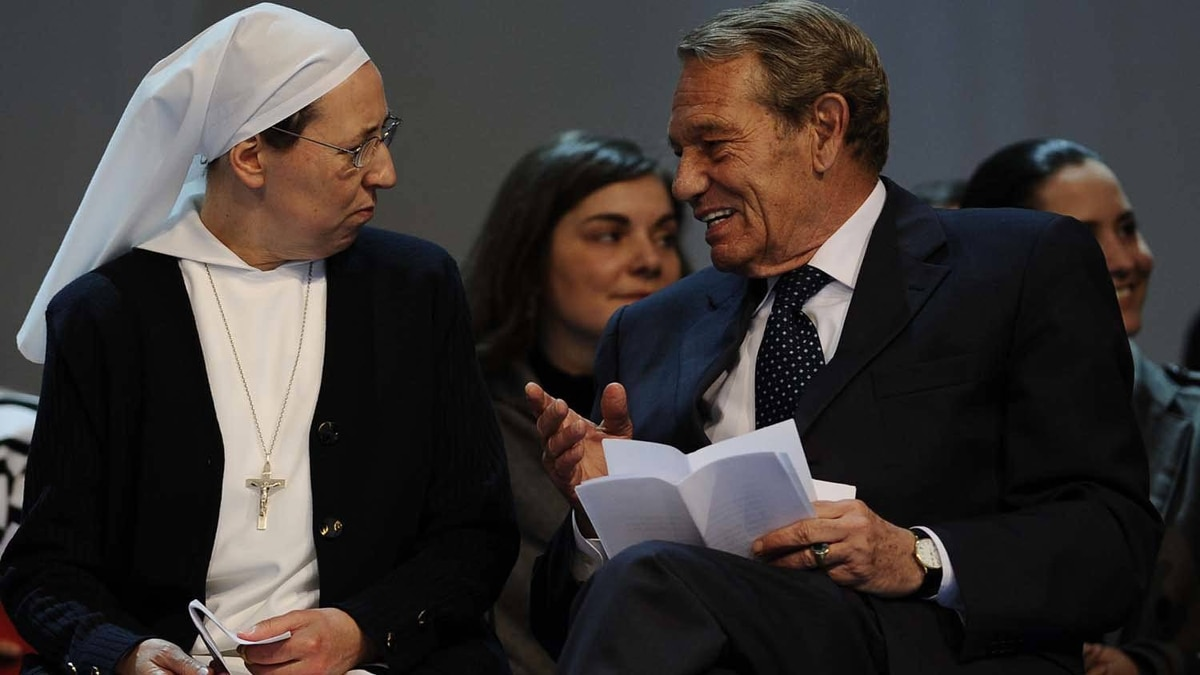 French nun Marie Simon-Pierre, left, takes place with the former pope's spokesman Joaquin Navarro Valls on stage at the ancient Circus Maximus arena prior a prayer vigil on April 30, 2011 in Rome.