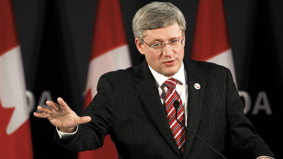 Canada's Prime Minister Stephen Harper answers reporters' questions during a news conference at the NATO Summit in Lisbon November 20, 2010.