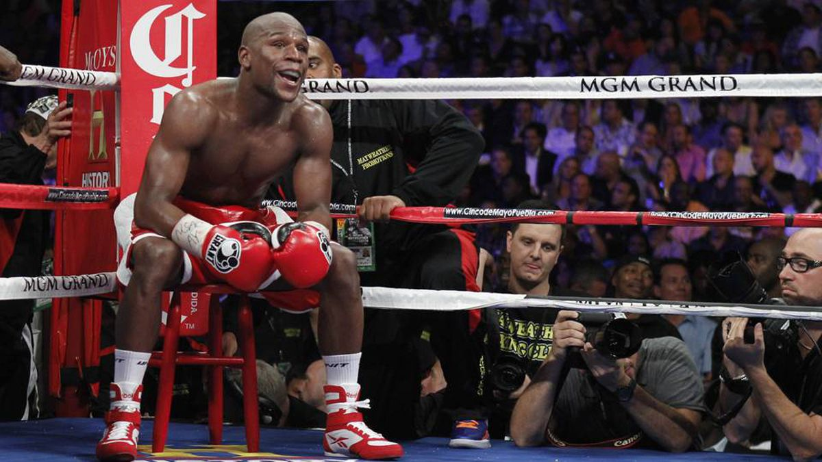 Floyd Mayweather Jr. of the U.S. sits on a stool as he waits for a round to start during his title fight against WBA super welterweight champion Miguel Cotto of Puerto Rico at the MGM Grand Garden Arena in Las Vegas, Nevada May 5, 2012.