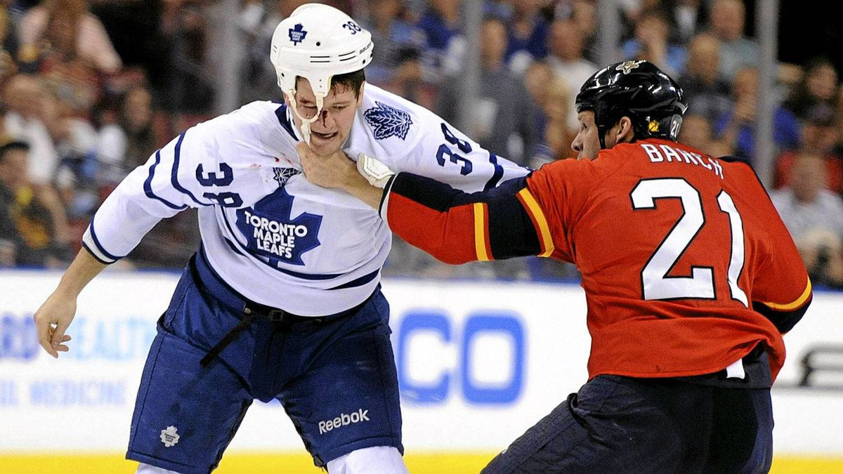 Toronto Maple Leafs' Jay Rosehill fights with Florida Panthers' Krystofer Barch during the first period in Sunrise, Florida, March 13, 2012.