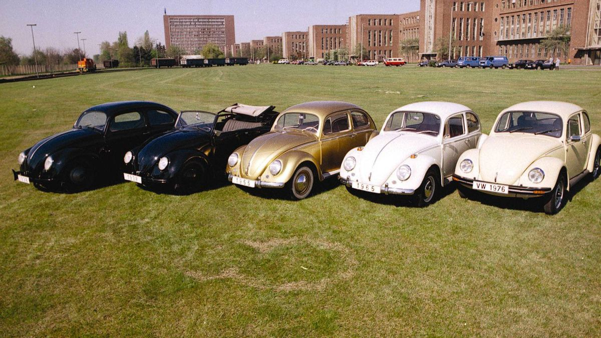 The distinctive shape of the original Beetle was maintained for more than 60 years. The Beetles in this picture illustrate the subtle changes that were made to the car over the decades. The car on the far right is a 1976 model - note the widened hood and windshield and bumpers that were raised to meet new government standards.