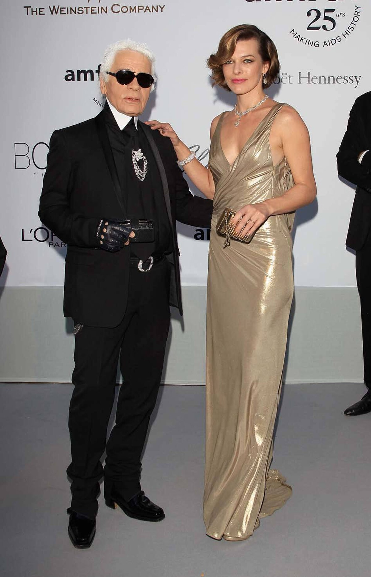 Karl Lagerfeld and Milla Jovovich attend amfAR's Cinema Against AIDS Gala at the Cannes Film Festival on Thursday.