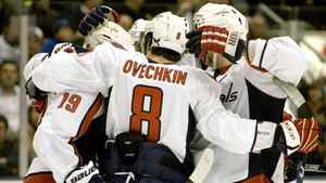 Washington Capitals Alex Ovechkin (C) celebrates a goal by teammate Nicklas Backstrom (L) against the Toronto Maple Leafs in the first period of their NHL hockey game in Toronto.