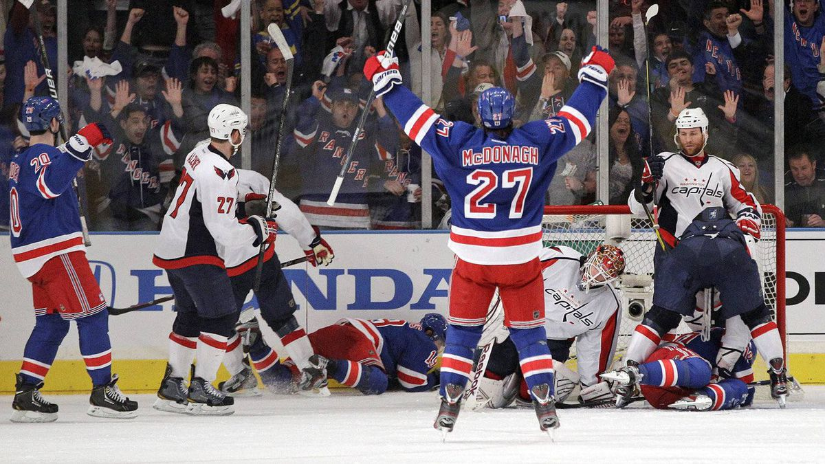 New York Rangers' Ryan McDonagh (27) and teammate Chris Kreider (20) celebrate a goal by teammate Brad Richards (19) as Washington Capitals goalie Braden Holtby reacts during the third period of Game 1 in the second round of the NHL hockey Stanley Cup playoffs Saturday, April 28, 2012, in New York. The Rangers won the game 3-1. (AP Photo/Frank Franklin II)
