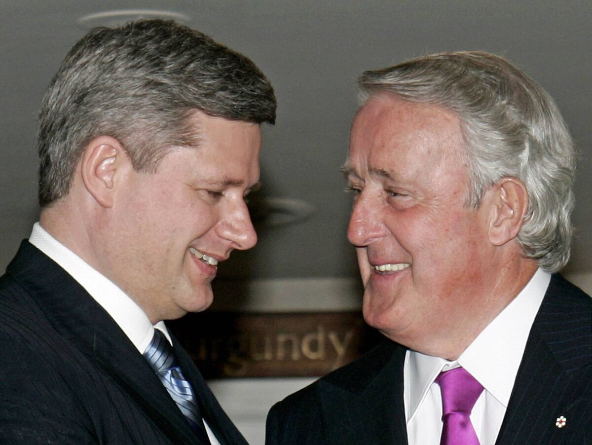Prime Minister Stephen Harper meets with former prime minister Brian Mulroney in Ottawa on April 20, 2006.