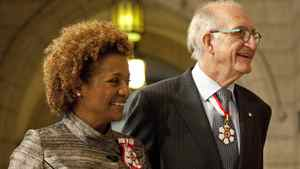 Governor General Michaelle Jean, left, and husband Daniel Lafond walk into the Senate Chamber on Parliament Hill for the installation of Governor General designate David Johnston in Ottawa on Friday, October 1, 2010.