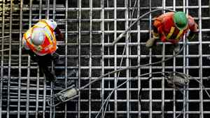 Workers stand on the foundation at a condominium construction project in Toronto, Ontario, Canada, on Monday, July 18, 2011. This week will bring reports on housing starts, building permits and the house price index.