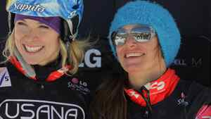 (L-R) Dominique Maltas and Maelle Ricker of Canada take the podium in second place in the ladies' team snowboardcross at the LG Snowboard FIS World Cup on December 17, 2011 in Telluride, Colorado. (Photo by Doug Pensinger/Getty Images)