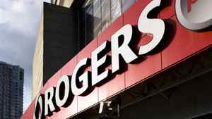 A customer's shadow casts on the sidewalk as he leaves a Rogers Plus store in the Rogers Centre in Toronto.