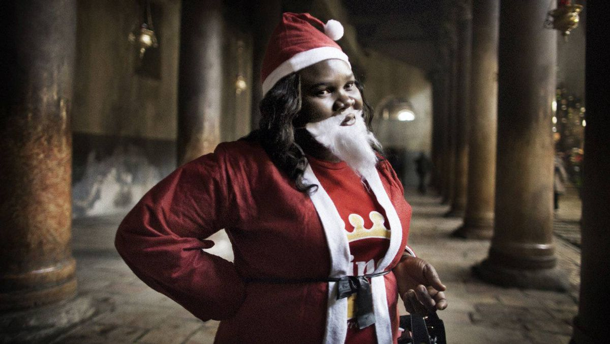A Christian pilgrim from Nigeria dressed as Santa Claus visits the Church of the Nativity in the West Bank city of Bethlehem on December 24, 2011. Christians began flocking to Bethlehem to celebrate Christmas following a tumultuous year of political upheaval and change across the Arab world. AFP PHOTO/MARCO LONGARI (Photo credit should read MARCO LONGARI/AFP/Getty Images)