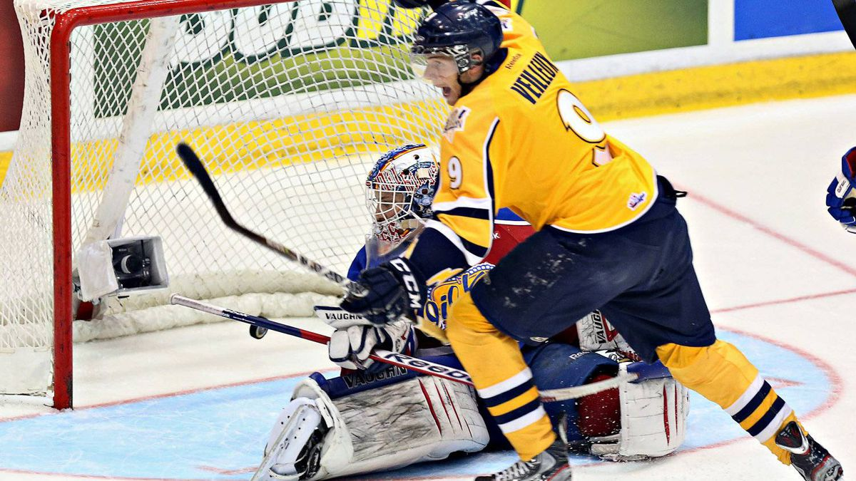 Shawinigan Cataractes Yannick Veilleux scores his team's first goal behind Edmonton Oil Kings goalie Laurent Brossoit during first period Memorial Cup action Thursday, May 24, 2012 in Shawinigan, Que.