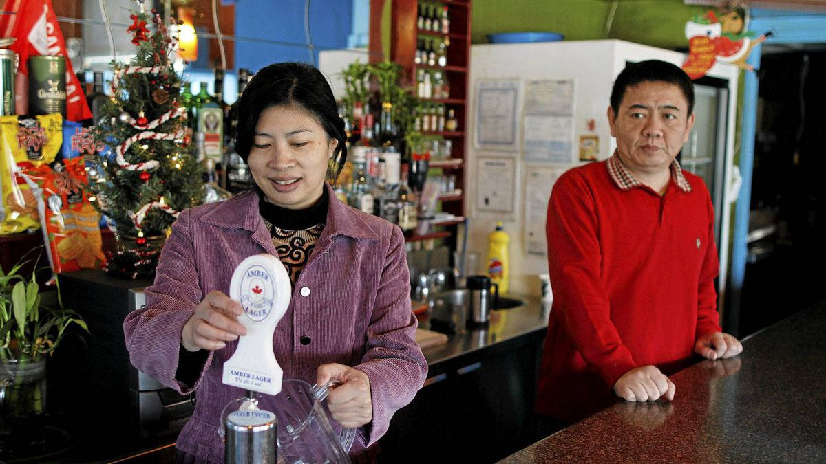 Jack Yang and Rosemary Lu, who immigrated from China to Canada photographed at their restaurant Fleur de Lis on Coxwell St., Toronto.
