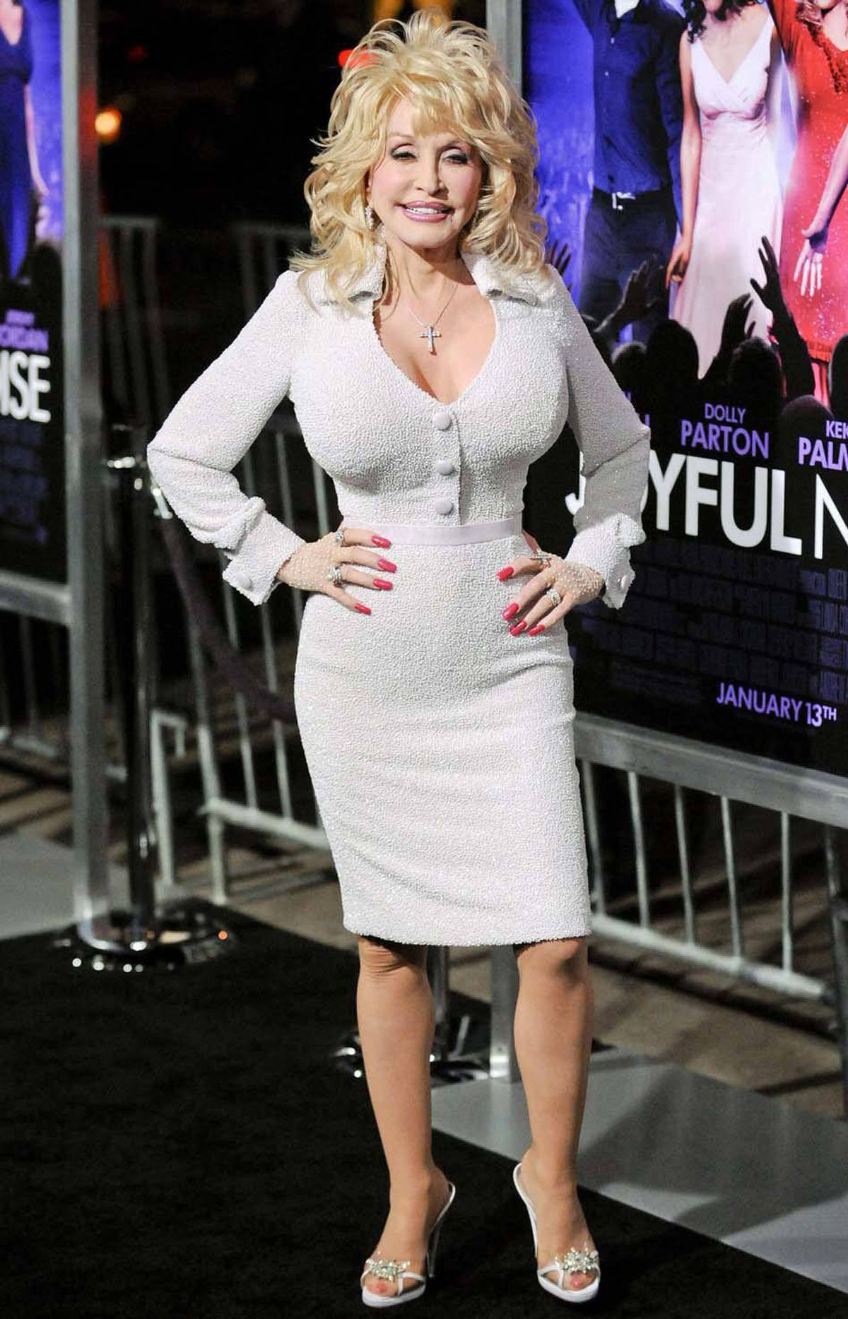 """Dolly Parton arrives at the Hollywood premiere of """"Joyful Noise"""" in Los Angeles on Monday wearing a dress that features a set of oversize buttons."""