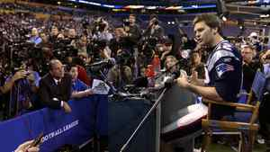 New England Patriots quarterback Tom Brady answers a question during Media Day in Indianapolis.