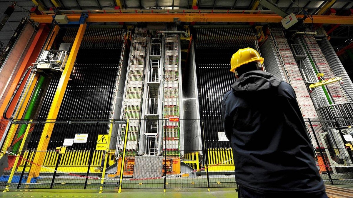 Picture taken on November 14, 2011 shows a scientist looking at the Oscillation Project with Emulsion-Racking Apparatus detector (OPERA) at the Gran Sasso National Laboratory (LNGS) located under the Gran Sasso mountain. A fiercely contested experiment that appears to show the accepted speed limit of the Universe can be broken has yielded the same results in a re-run, European physicists said on November 18, 2011.