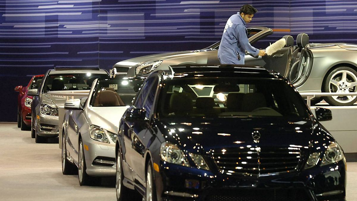 Workers dust off the cars Wednesday, Feb. 8, 2012 at McCormick Place in Chicago as they get ready for the 2012 Chicago Auto Show which opens to the public this Friday. (AP Photo/Daily Herald, Mark Welsh)