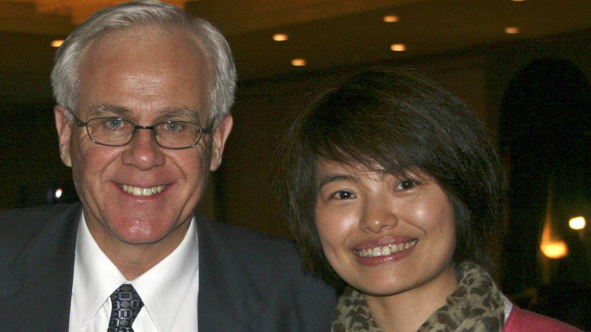 Conservative MP Bob Dechert and Shi Rong, a correspondent with China's state-run news agency.