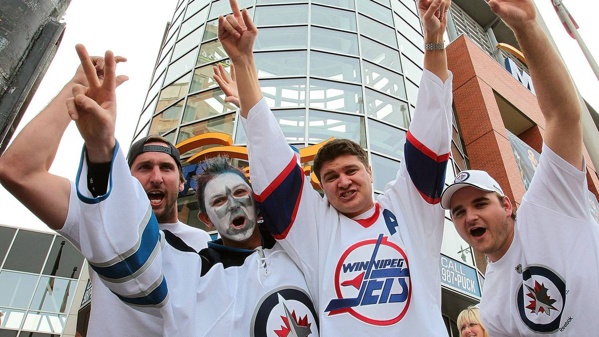 Winnipeg Jets fans (L-R) Andrew Sinclair, Eric Hogue, Kyle MacKay and Tyler Contant make their way to the MTS Centre before the Winnipeg Jets game against the Montreal Canadiens for NHL action at the MTS Centre on October 9, 2011 in Winnipeg, Manitoba, Canada. The game is Winnipeg's first NHL regular season game in 15 years. (Photo by Marianne Helm/Getty Images)