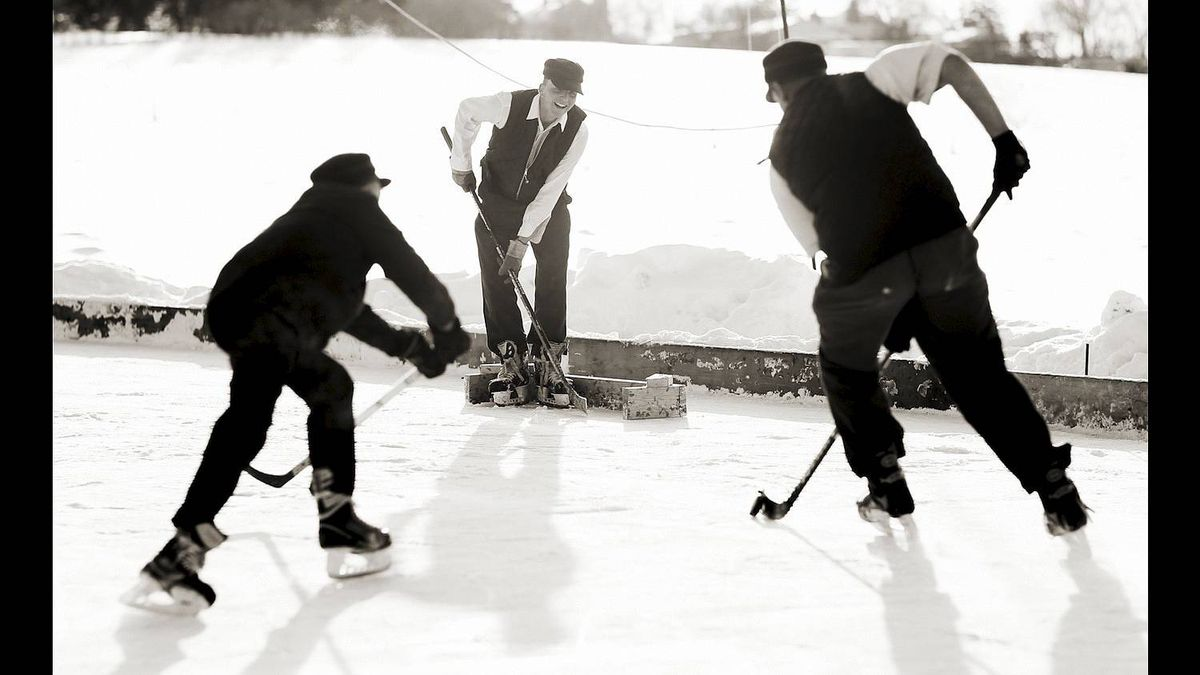 The small lumber goal is defended by a player during a game of shinny hockey played by Mennonite boys, aged 15-18, in Wallenstein, Ontario on Jan 8, 2011. (Photo by Peter Power/The Globe and Mail)
