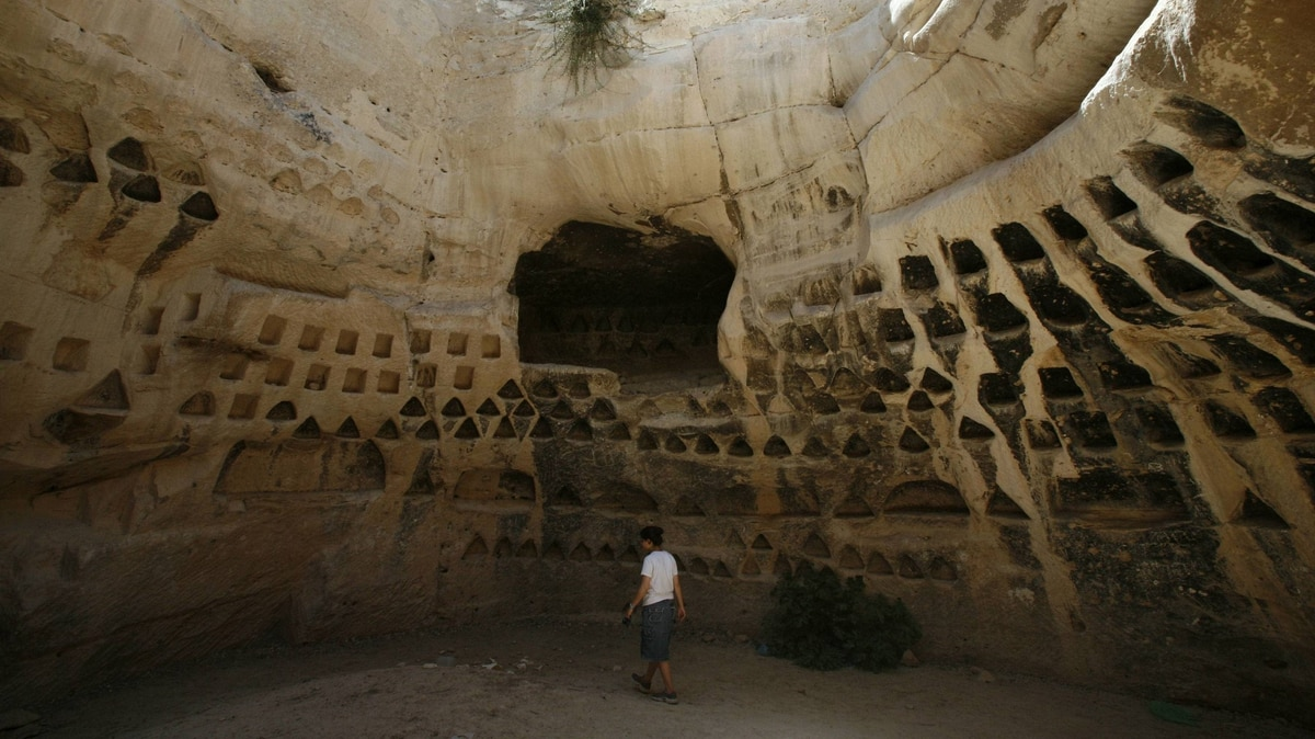 A tourist walks inside a columbarium at Hirbet Madras archaeological site, featuring ancient rebel hideouts, at the foothills of Jerusalem around the ancient city of Beit Guvrin August 23, 2011.