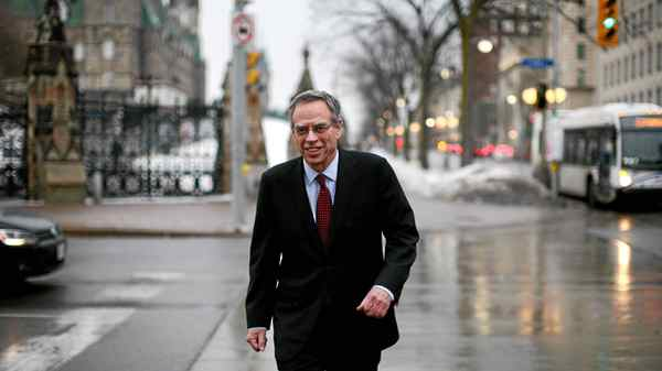 Natural Resources Minister Joe Oliver photograph walking back to his office on Parliament Hill in Ottawa.
