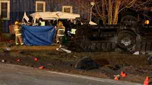 Ontario Provincial Police and emergency crews investigate a multiple fatal motor vehicle accident near Hampstead, Ont., Feb. 6, 2012. Police say 11 people died in the crash.