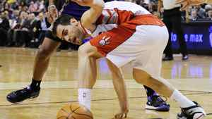 Toronto Raptors Jose Calderon loses the ball during the first half of an NBA basketball game in Toronto, February 25, 2011.