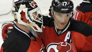 New Jersey Devils' Ilya Kovalchuk (17), of Russia, hugs goaltender Martin Brodeur after they defeated the New York Islanders 5-1 in an NHL hockey game on Thursday, March 8, 2012, in Newark, N.J. (AP Photo/Bill Kostroun)