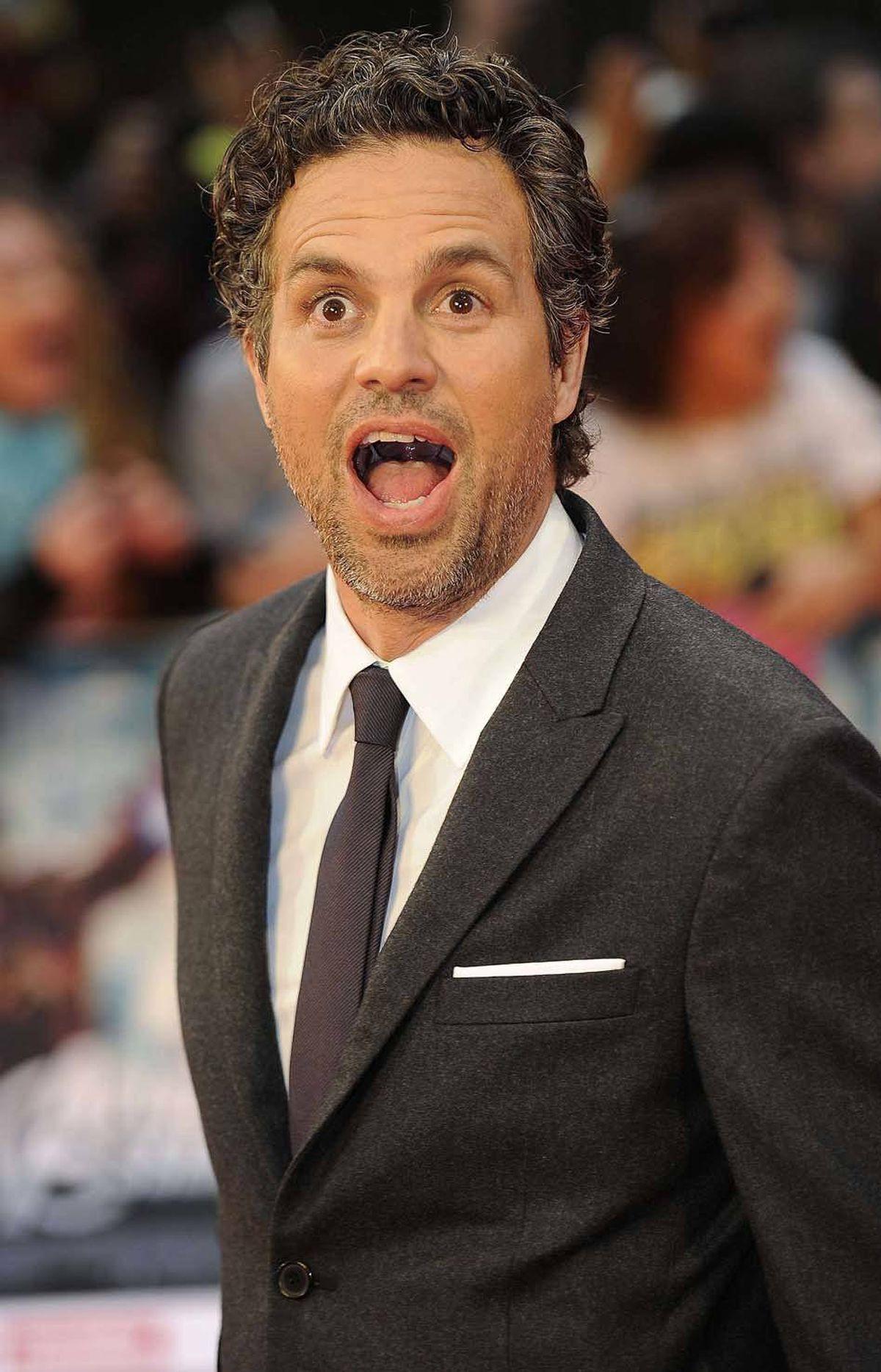 "Mark Ruffalo asks bystanders whether there is anything wrong with the inside of his mouth at the premiere of ""Avengers Assemble"" in London last week."