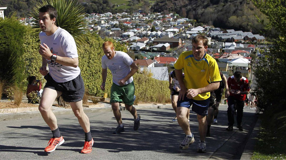 "Competitors take part in the traditional ""Steepest Race in the World"" in Baldwin street in Dunedin September 18, 2011. Baldwin street is the world's steepest street, according to the Guinness Book."