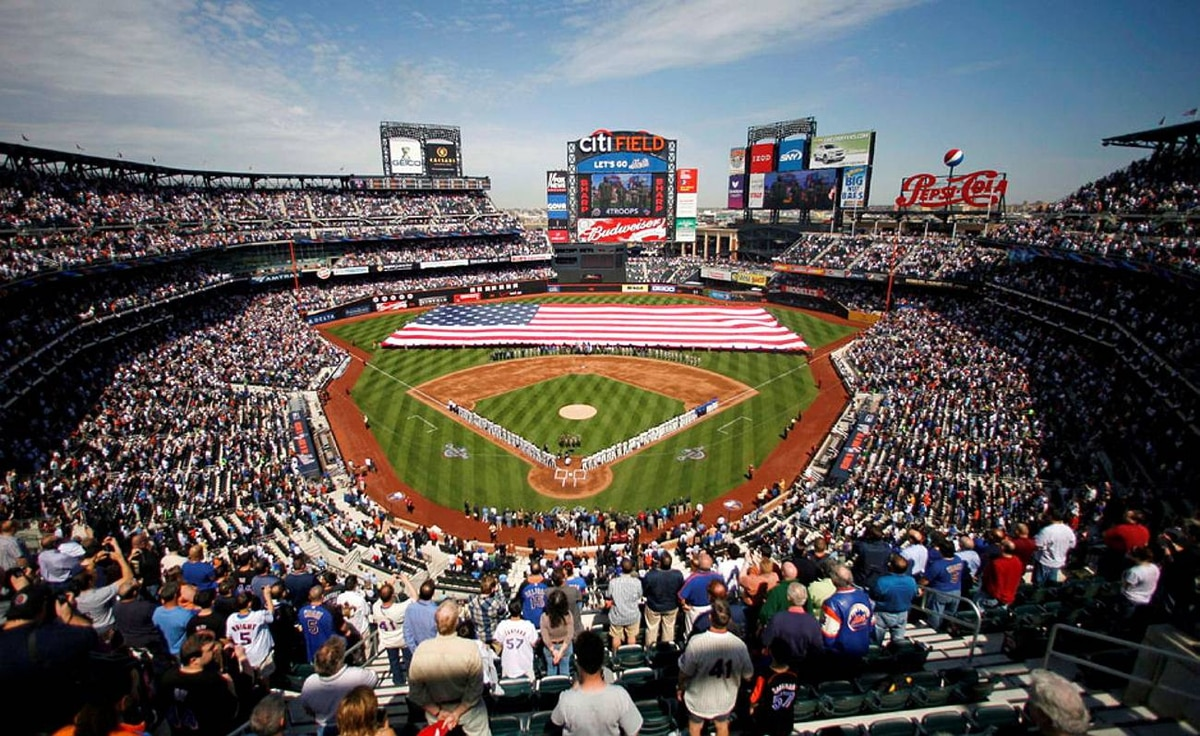 Fans stand for the national anthem before the MLB major league baseball opening day game between the Florida Marlins and New York Mets in New York April 5, 2010.