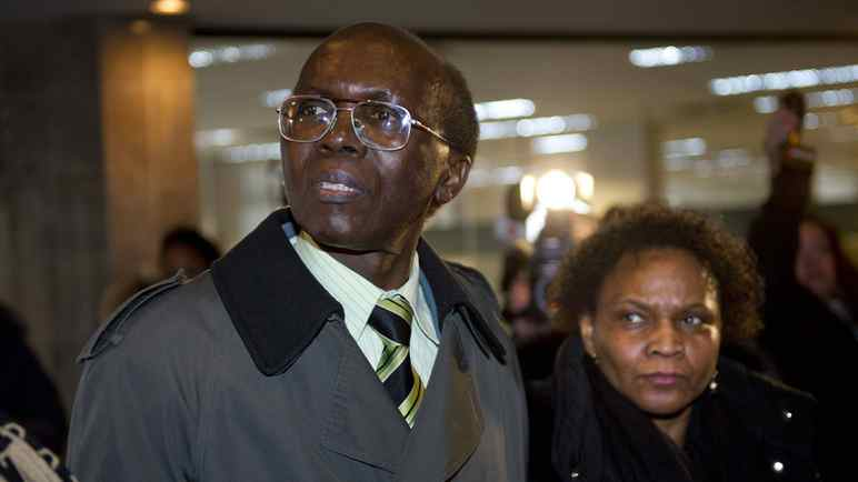 Leon Mugesera arrives with his wife, Jemma, at the Federal Court building in Montreal on Monday.